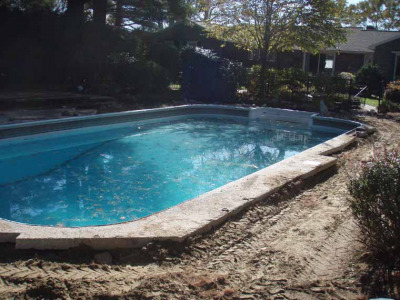 With demolition complete, work begins on the pool oasis.