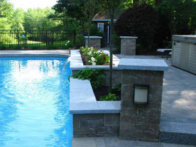 The completed project updates an aging patio around a pool, breathing new life into this area.