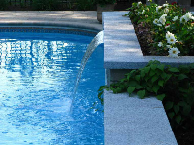 The raised planter provided the height needed for the water feature. The waterfall is neatly hidden under the granite cap resulting in a simple yet dramatic effect.