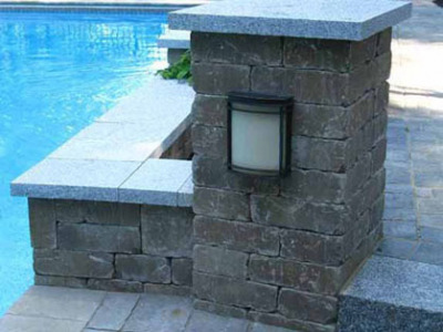 Use of granite is repeated in the steps and the cap on the planters and columns. The night lighting allows for more use long into the night.