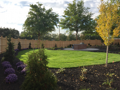 The plan comes together with the new planting beds and sod lawn areas.