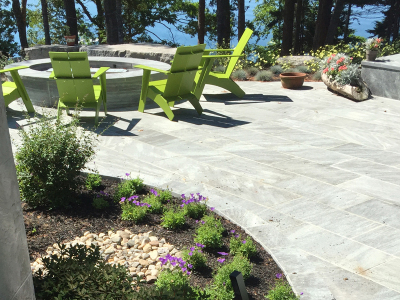 The oceanfront patio has large planting beds for seasonal interest.
